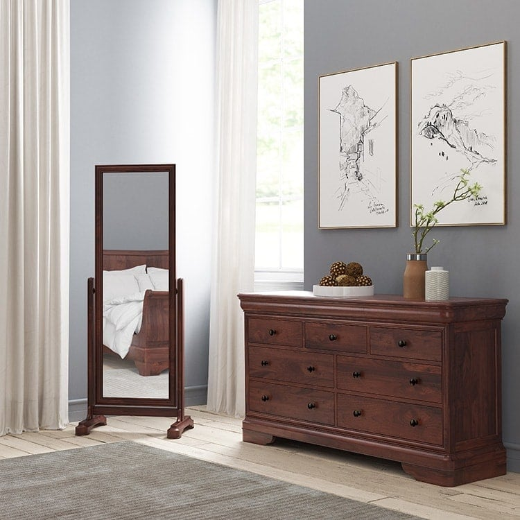 Antoinette dark mahogany 4+3 drawer besides a cheval floor mirror in a room set