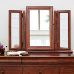 Antoinette dark mahogany gallery mirror resting above a chest of drawers