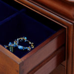 Antoinette dark mahogany close up of drawer showing the blue felt inserts