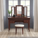 Antoinette dark mahogany dressing table with stool in a room set